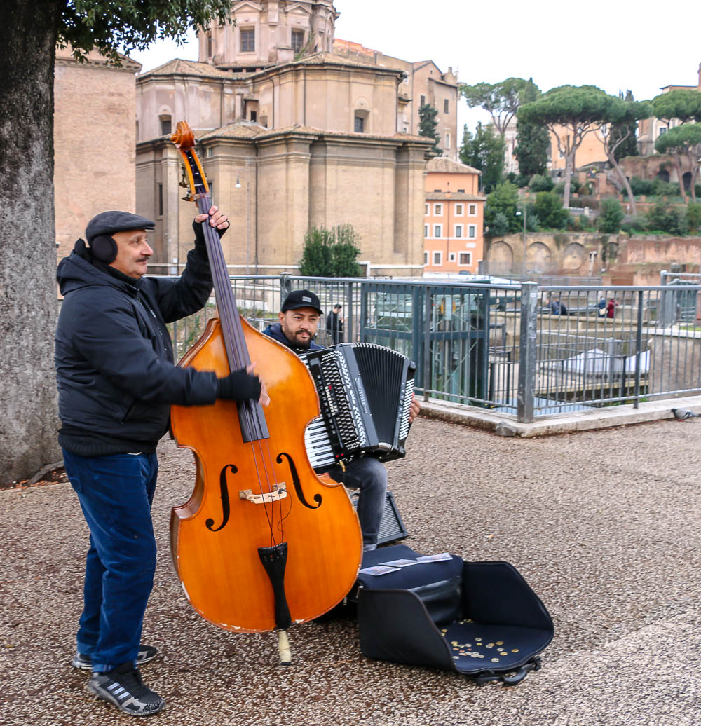 Street performance in front of Roman Forum, roadsanddestinations.com